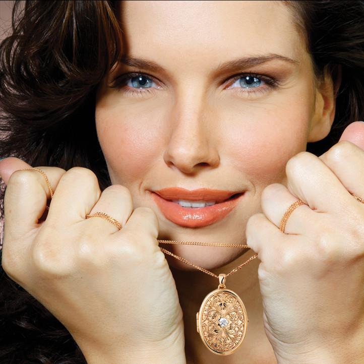 0.40 carat diamond design medallion in red gold