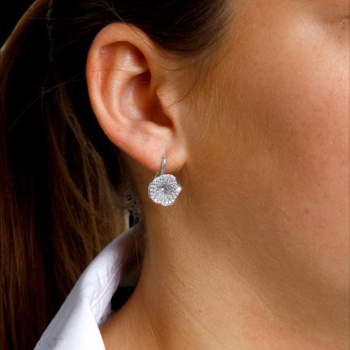 0.76 carat diamond design earrings in white gold