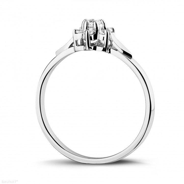 0.15 carat diamond flower ring in white gold