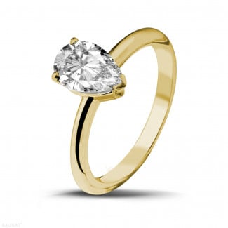 - 1.50 carat solitaire ring in yellow gold with pear shaped diamond