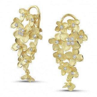 黄金钻石耳环 - 设计系列0.70克拉花之恋黄金钻石耳环
